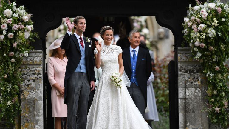 Pippa Middleton and her husband James Matthews leave the church in Englefield