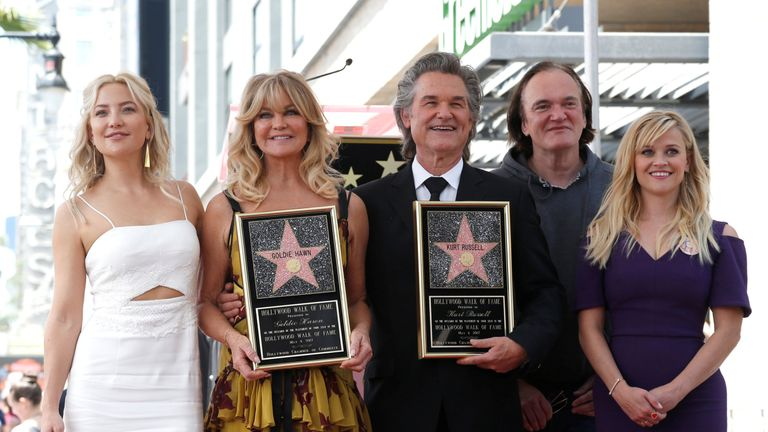 Russell and Hawn pose with daughter Kate Hudson, Quentin Tarantino and Reese Witherspoon