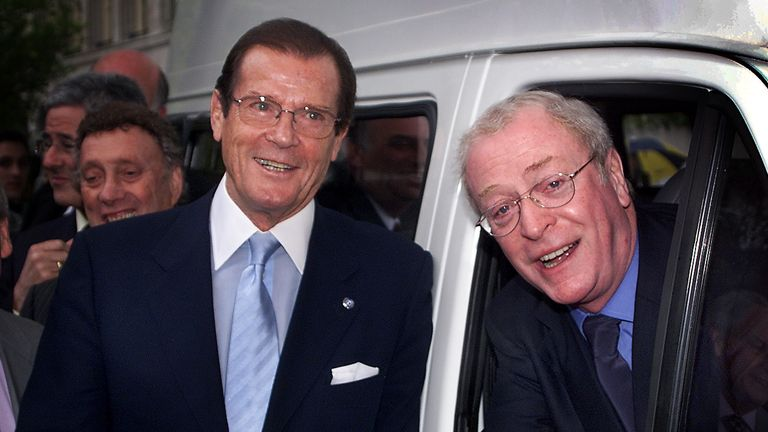Here he poses with fellow British actor Michael Caine in 2000