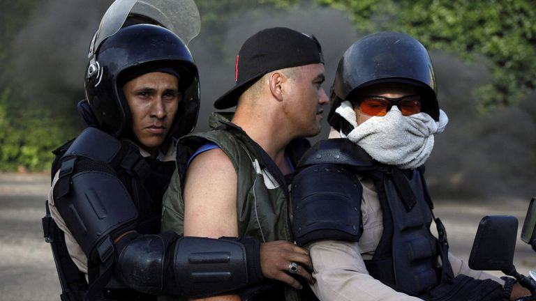 A demonstrator is detained by riot security forces during a protest against Venezuela's President Nicolas Maduro's government in Tariba