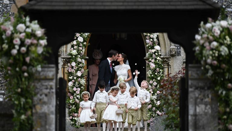 The page boys and bridesmaids, including Prince George and Princess Charlotte leave the church ahead of Pippa and James Matthews