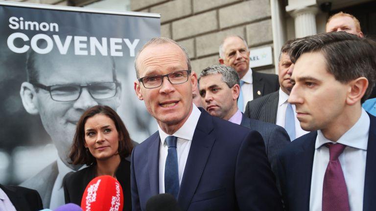 Minister for the Environment and Housing Simon Coveney (centre) alongside Minister for Health Simon Harris (right) outside Fine Gael HQ in Dublin