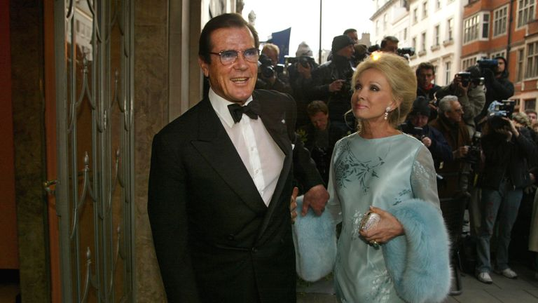 2002: Roger Moore and his wife arrive for the wedding of Joan Collins
