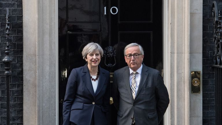 Theresa May with Jean-Claude Juncker at Downing Street last week