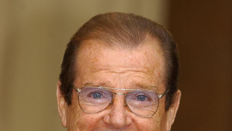 2003: Roger Moore receives his knighthood