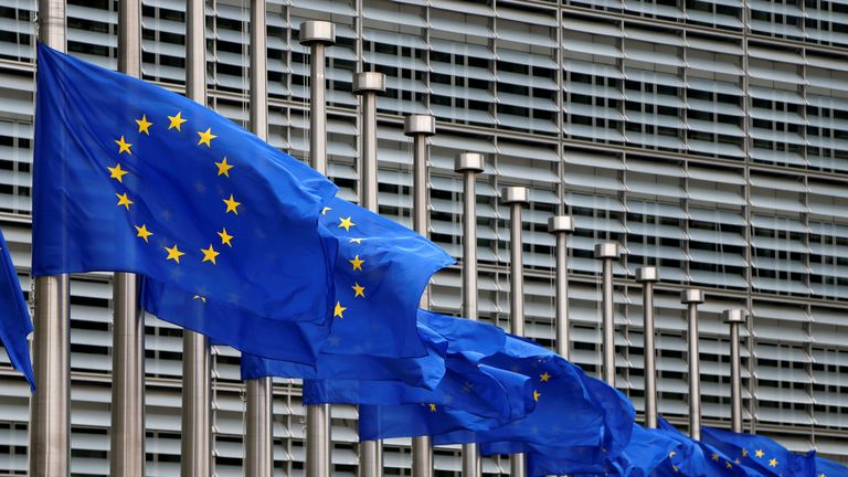 European Union flags are lowered at half-mast in honour of the victims of the Manchester attack outside the European Commission in Brussels, Belgium