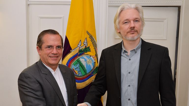LONDON, ENGLAND - AUGUST 18: WikiLeaks founder Julian Assange (R) shake hands with Ecuadorian Foreign Minister Ricardo Patino after a press conference, where he confirmed he 'will be leaving the embassy soon', in the Ecuadorian Embassy on August 18, 2014 in London, England. Mr Assange has been living in the embassy since June 2012 in an attempt to avoid extradition to Sweden where he faces allegations of sexual assault. (Photo by John Stillwell - WPA Pool/Getty Images)