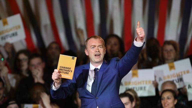 Tim Farron brandishes a copy of the Liberal Democrat manifesto