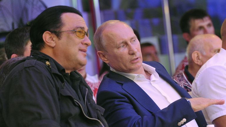 Russian President Vladimir Putin (R) speaks with US actor Steven Seagal