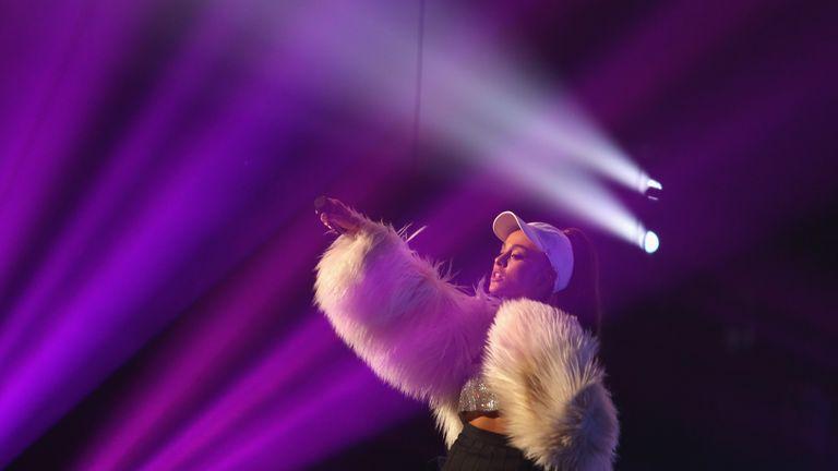 Ariana Grande performing in December