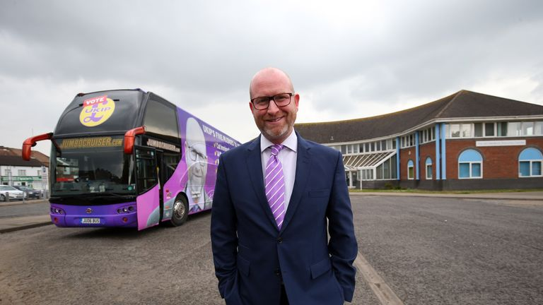 UKIP Leader Paul Nuttall smiles as he poses by the UKIP campaign bus