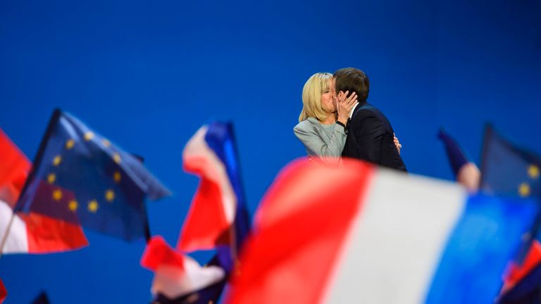 Emmanuel Macron kisses his wife Brigitte