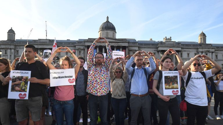 People in Trafalgar Square, London, also joined in the vigil