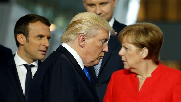 Donald Trump walks past Angela Merkel at a NATO summit on 25 May, 2017.