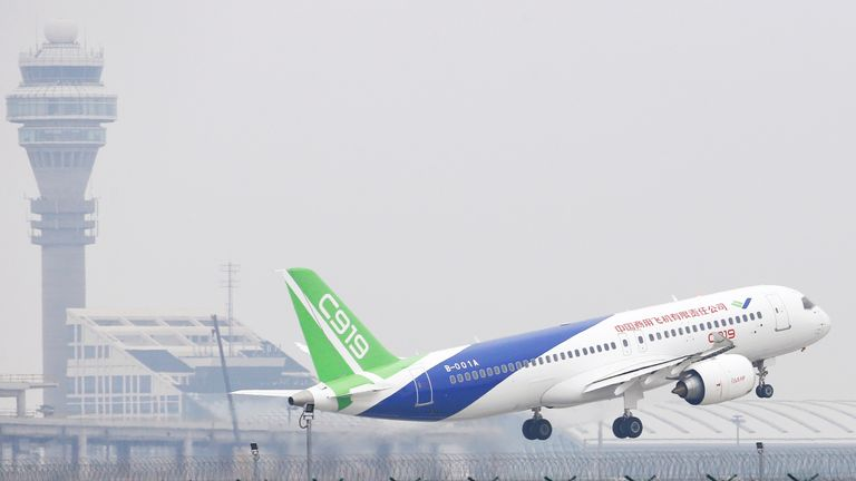 China's home-grown C919 passenger jet takes off from the Pudong International Airport ahead of its scheduled maiden flight in Shanghai, China.