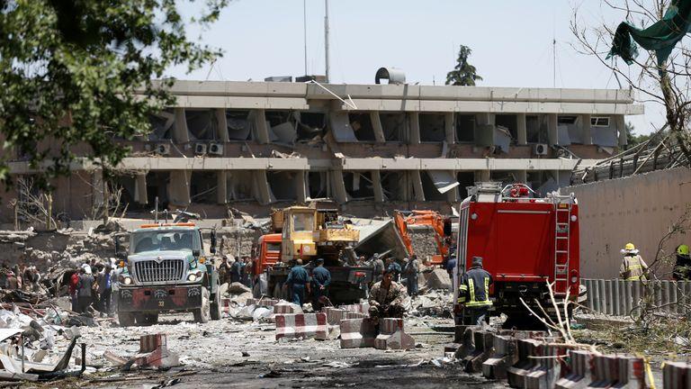 Construction vehicles at the damaged German embassy