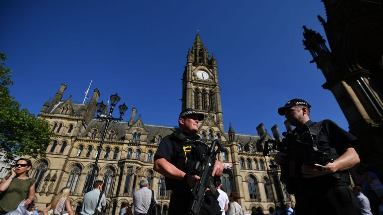 Armed police in front of the Town Hall in Albert Square, Manchester