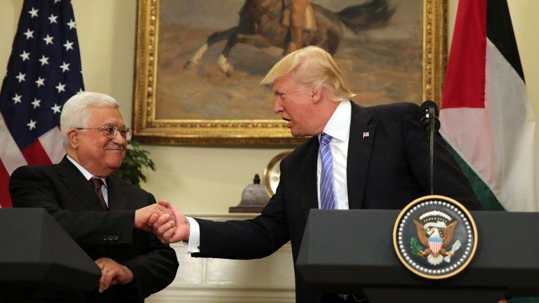 US President Donald Trump shakes hands with Palestinian President Mahmoud Abbas