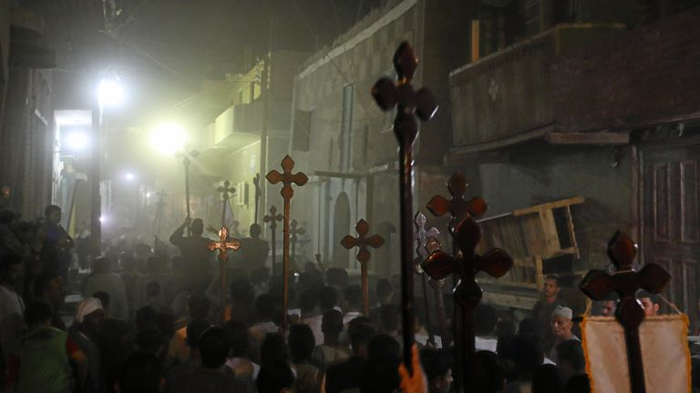 Mourners carry crosses after the funeral of the Coptic Christians killed in Minya, Egypt
