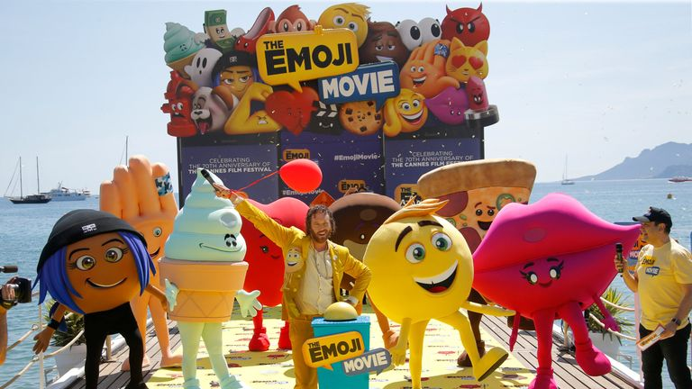 """T. J. Miller poses during a photocall for the film """"The Emoji Movie"""""""