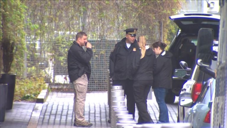 Forensic officers outside the building
