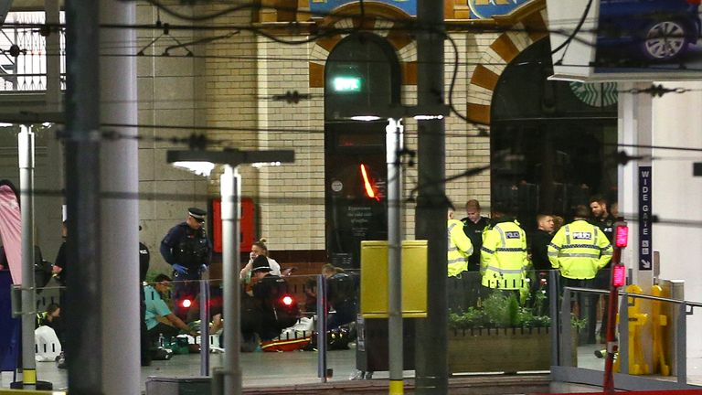 Members of the public receive treatment from emergency service staff at Victoria Railway Station close to the Manchester Arena