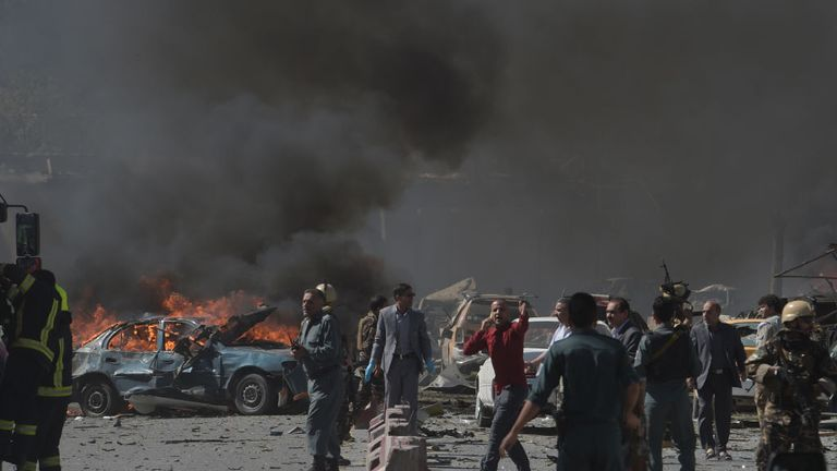 Security forces try to move civilians away from the blast zone