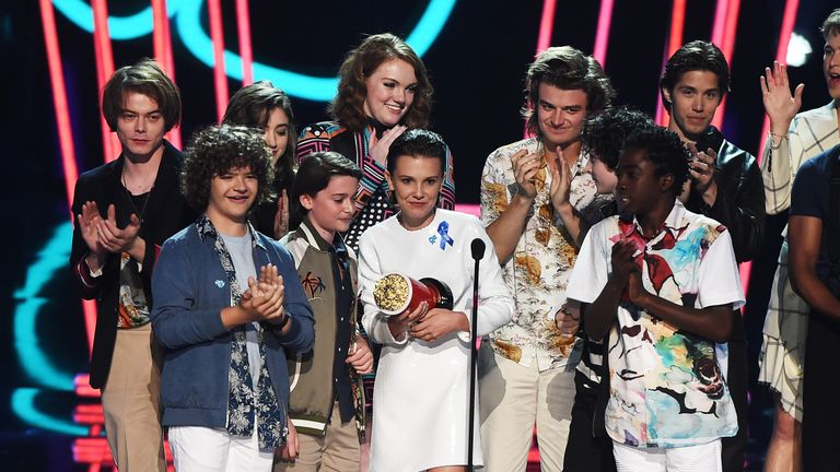 The cast of Stranger Things accept the Show of the Year gong at the MTV Awards