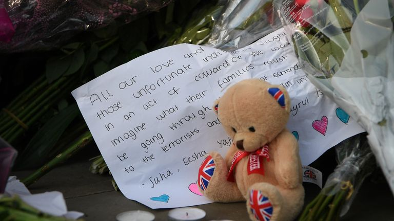 A teddy bear is left as a mark of respect to those who died or were caught up in the attacks