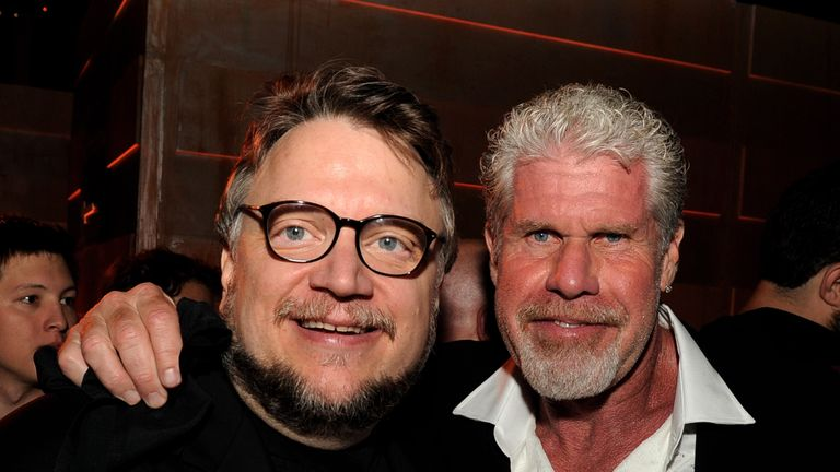 LOS ANGELES, CA - JULY 09: Director Guillermo del Toro (L) and actor Ron Perlman pose at the after party for the premiere of Warner Bros. Pictures and Legendary Pictures' 'Pacific Rim' at Hollywood and Highland on July 9, 2013 in Los Angeles, California. (Photo by Kevin Winter/Getty Images)