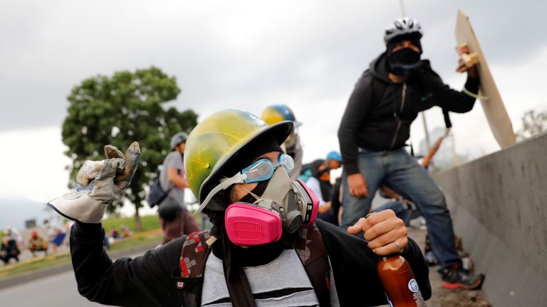 Protesters demonstrating against Venezuela's government gear up for violent clashes with police