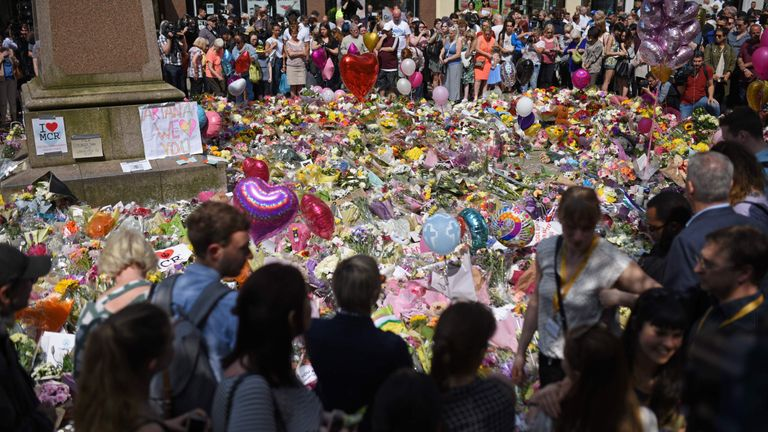 Crowds gather at St Ann's Square in Manchester