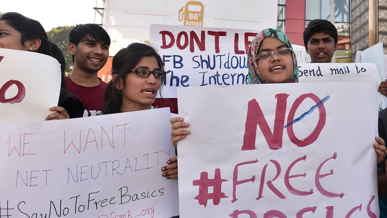 Indian demonstrators of Free Software Movement Karnataka hold placards during a protest against Facebook's Free Basics initiative, in Bangalore on January 2, 2016. The group's demonstration was aimed at urging members of the public to say 'no to free basics' which they allege will affect net neutrality and give Facebook monopoly over the internet