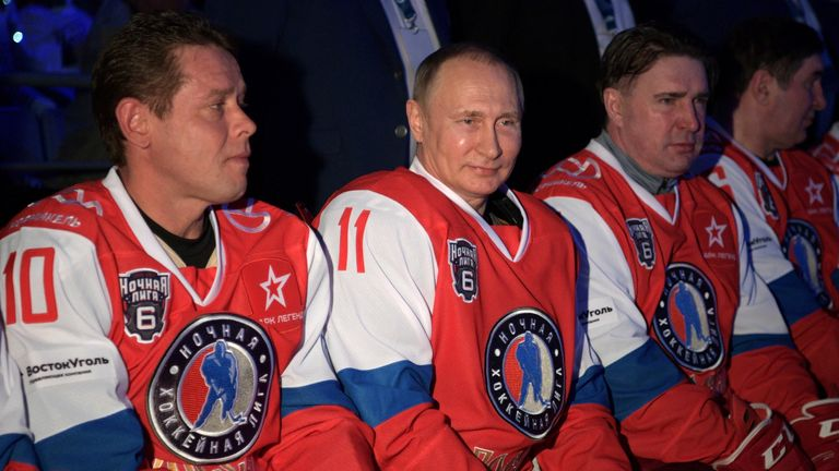 Russian President Vladimir Putin (C) attends a gala match of the hockey teams of the Night League in Sochi, Russia