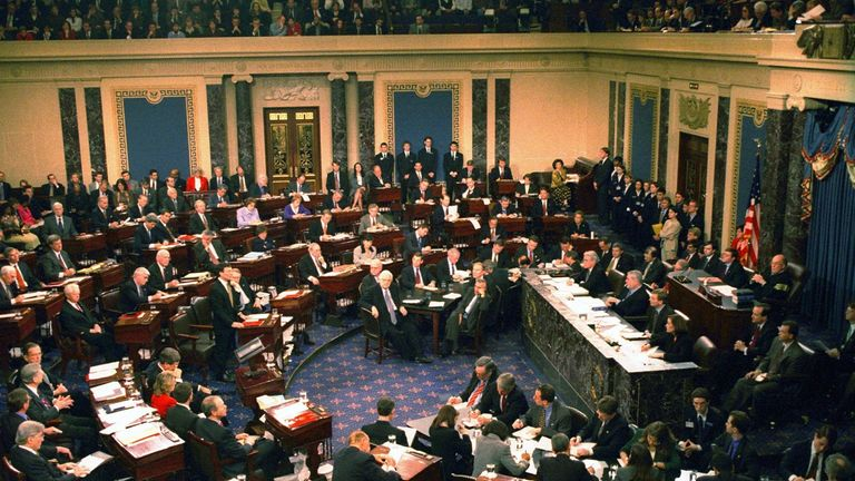 The US Senate votes in its trial against impeached US President Bill Clinton on February 12,1999