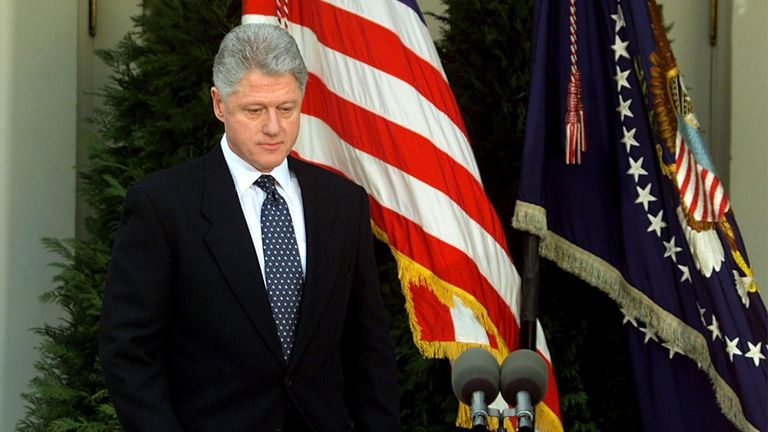 US President Bill Clinton walks to the podium moments before reading a statement in the Rose Garden of the White House after the Senate voted not to impeach him