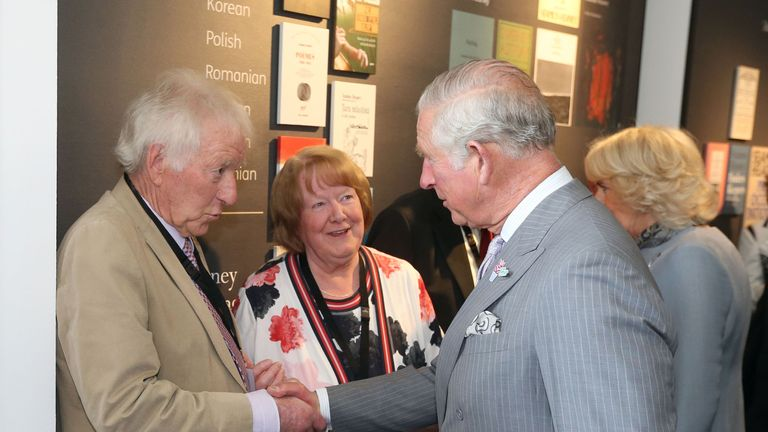 Prince Charles shakes hands with Seamus Heaney's brother Hugh