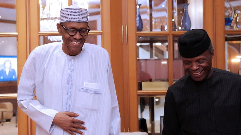 Nigerian President Muhammadu Buhari (L) smiles next to his deputy Yemi Osibanjo in Abuja, Nigeria, May 7, 2017