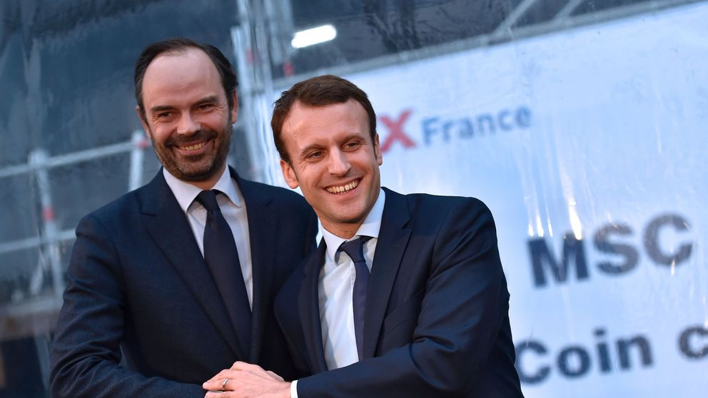 Emmanuel Macron and Edouard Philippe shake hands during a meeting in February 2016