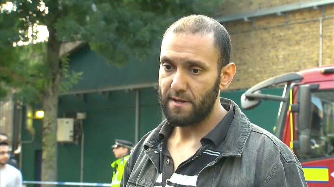 Tower block resident talking in interview.