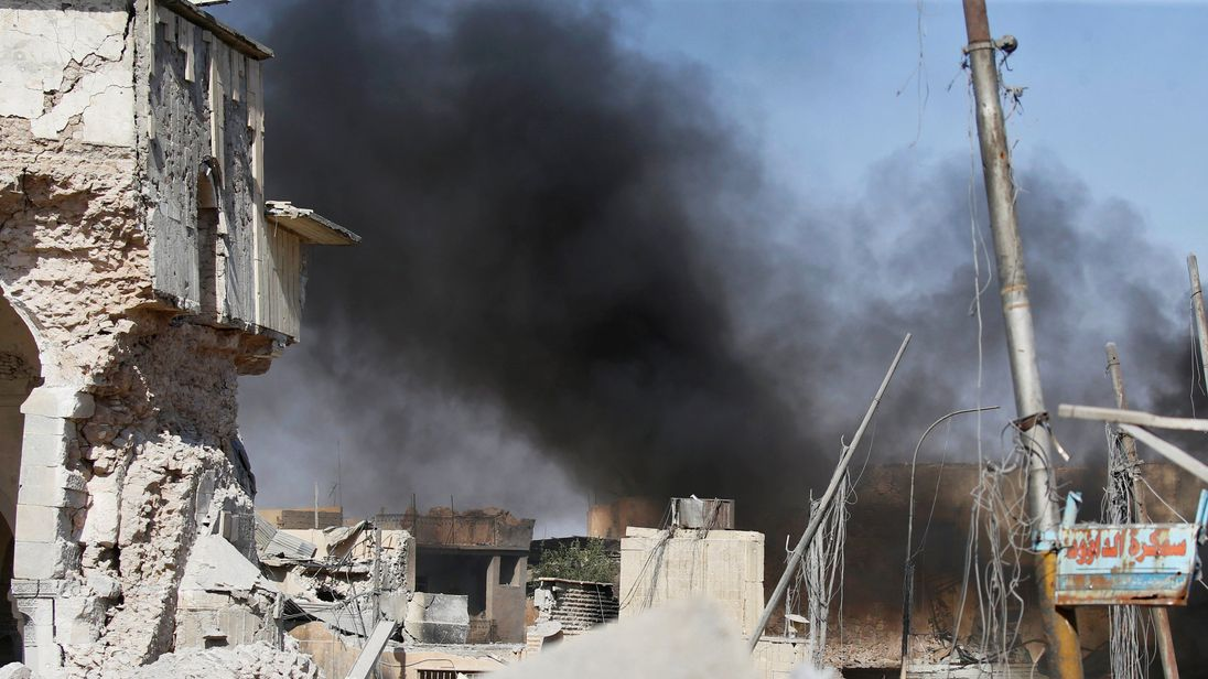Smoke billows from the ruins of Grand al-Nuri Mosque after it was retaken by the Iraqi forces from the Islamic State militants at the Old City