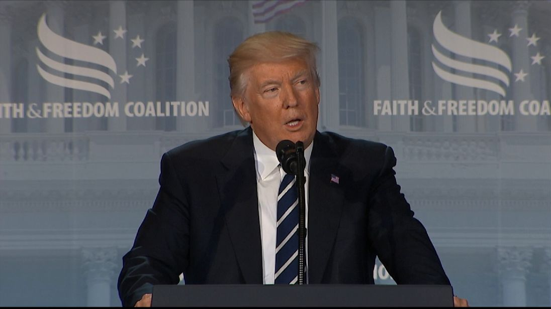 Donald Trump makes oblique references to being 'under siege' at an address to the Faith and Freedom Coalition