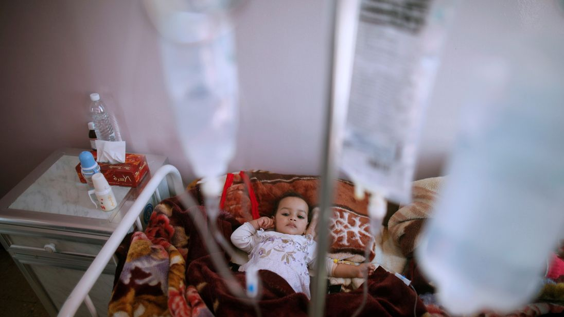 A girl with cholera receives treatment through a drip in a centre in Sanaa Yemen