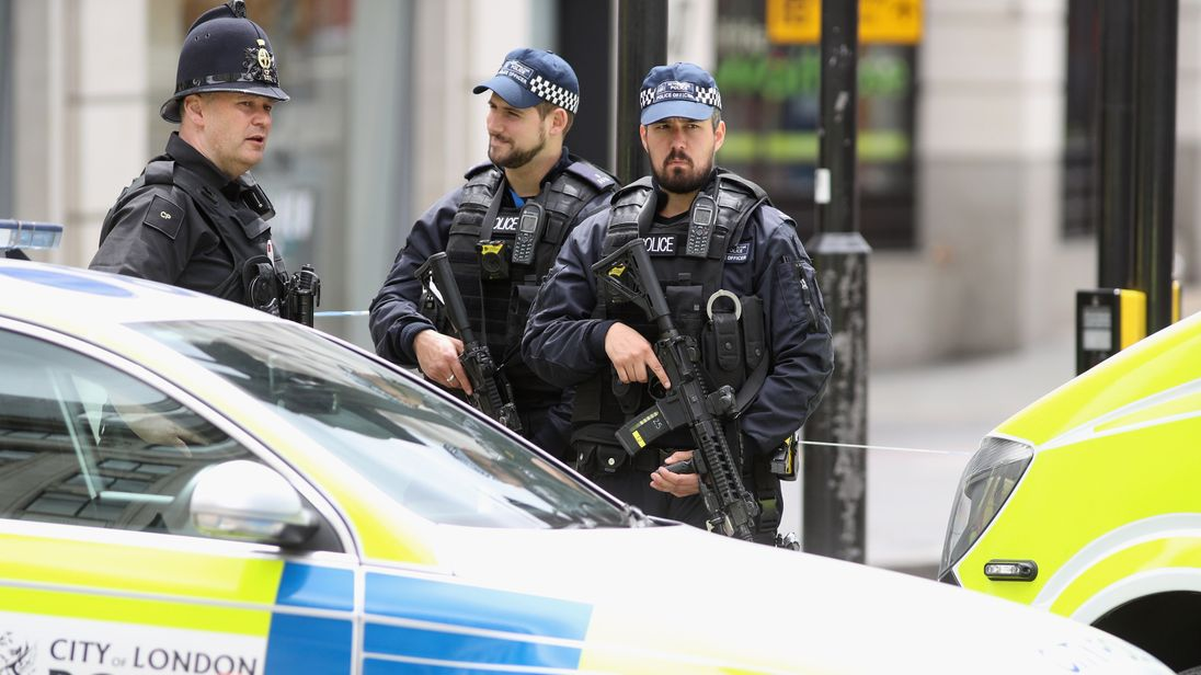 Armed police officers at a cordon on London Bridge