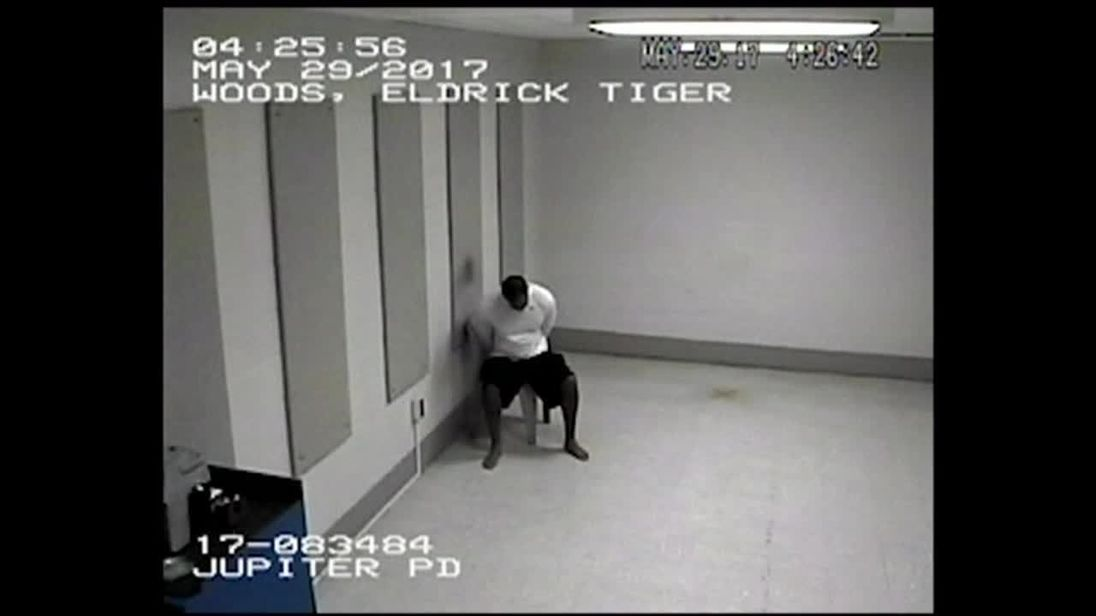Tiger Woods slumps in his chair after arrest.
