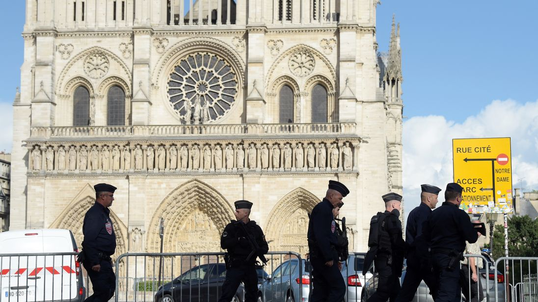 Police patrol the Notre Dame neighbourhood in Paris after a man attacked police officers with a hammer on 6 June.