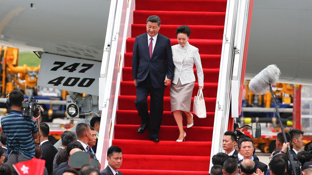 President Xi Jinping arrives in Hong Kong with his wife