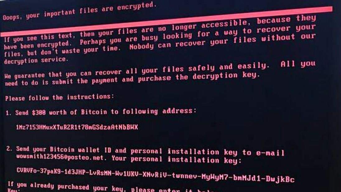 Picture of a computer screen displaying the message shown to hacked computers