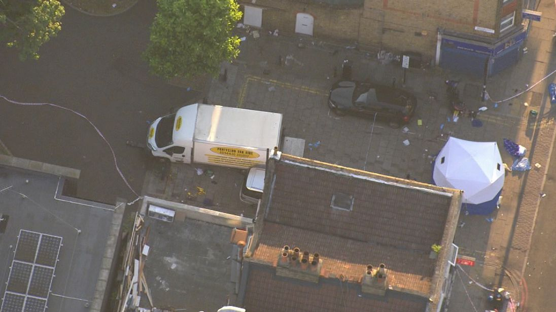 A police forensic tent and a van at the scene of the Finsbury Park attack