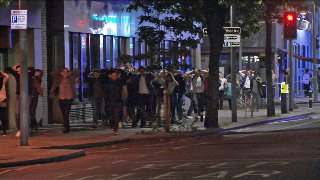 Police order members of the public to exit a cordon near London Bridge